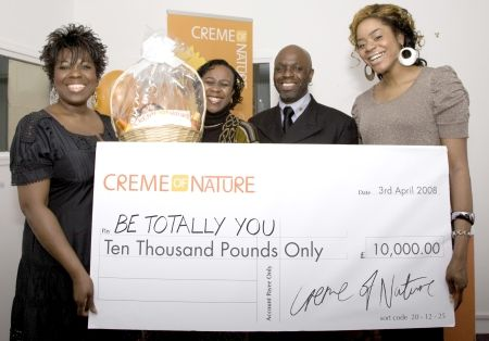 Ellen Thomas (l), Antonia Okonma (r) and Randolph Gray present the £10,000 cheque to 2008 winner Beverley Ejimofo