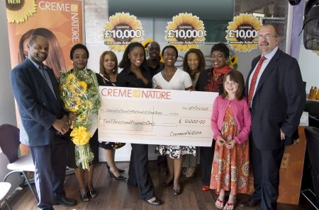 Dona Croll and Randolph Gray present £10,000 to 2009 winners, Shern Hall Youth Steel Band